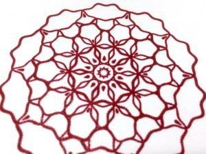 radial-geometry-red-closeup-by-ambigraph